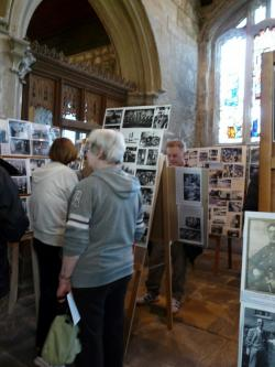 people looking at a local history diaplay in a church