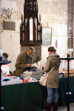 volunteers working in a church shop