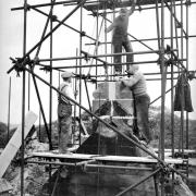men working on a church tower